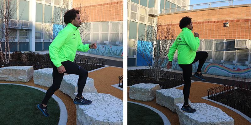 A man performs a bench step up
