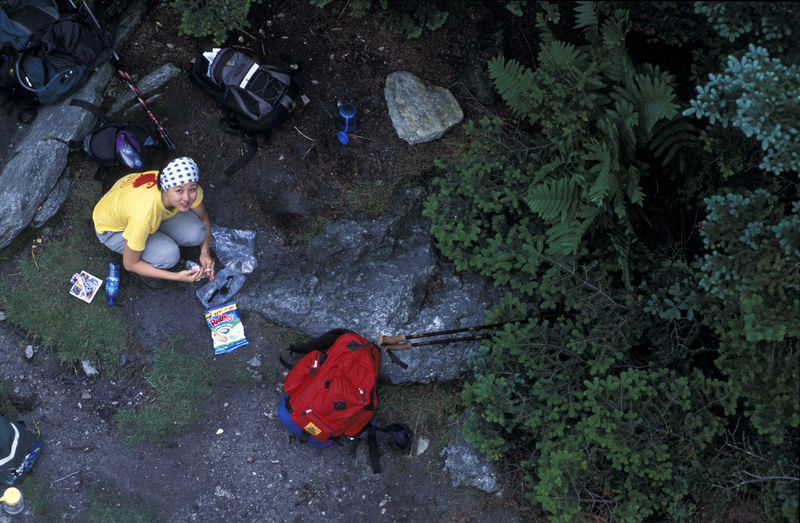 A woman stops to prepare lunch on the Appalachian Trail.